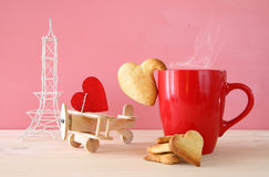 Wooden plane with heart next to cup of coffe Stock Image