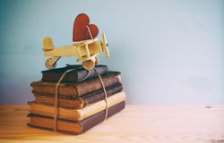 Wooden plane with heart on the stack of old books Stock Image