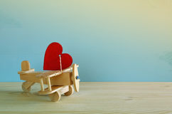 Wooden plane with heart on the table Stock Photography