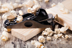 Wooden plane and shaving Royalty Free Stock Images