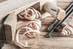 Wooden planer and filings Royalty Free Stock Photography
