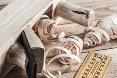 Wooden planer and filings Royalty Free Stock Images