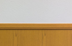 Wooden plank against white concrete wall. banner background. Stock Photography