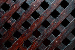 Wooden plank background. Wooden plank cross bacground with nails dark furniture Royalty Free Stock Images