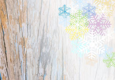 Wooden plank background with colorful snowflake Royalty Free Stock Images