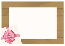 Wooden Plank Background with Pink sheet of paper and  Square Gift Box with Red   Bow. Stock Photography
