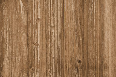 Wooden plank background, warm light-brown color, vertical boards, wood texture, old table (floor, wall), vintage.  royalty free stock photos