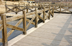 A wooden plank boardwalk royalty free stock images