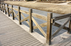 A wooden plank boardwalk. On the pond to summerhouse in a garden Royalty Free Stock Photography
