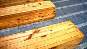 Wooden Plank Boxed Benches on the Floor. Yellow Brown Wooden Plank Boxed Benches on the Floor stock photography
