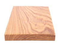 A wooden plank close-up. Is located on the white background Royalty Free Stock Images