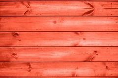 Wooden plank coral colour wall background outdoors. stock images