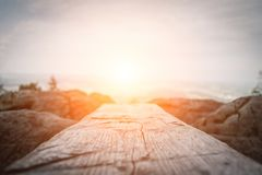 Wooden plank in front of the nature during the sunset. stock photography