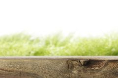 Wooden plank and grass Royalty Free Stock Images