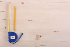 Wooden plank and measuring tape Royalty Free Stock Image