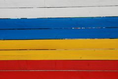 Wooden Plank Painted Red, Yellow and Blue Boards, Colored Elements stock photography