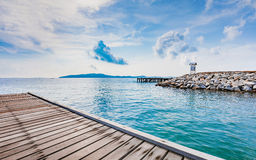 Wooden plank pier with seascape and bright blue sky Royalty Free Stock Photography