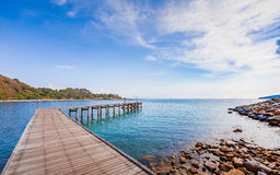 Wooden plank pier with seascape and bright blue sky Stock Photography
