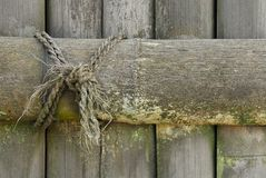 Wooden plank and rope Stock Photos