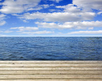 Wooden plank with sea or ocean and blue sky Stock Images