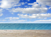 Wooden plank with sea or ocean and blue sky Stock Photo