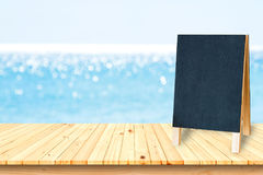 Wooden plank shelves and black board and white background. Royalty Free Stock Images