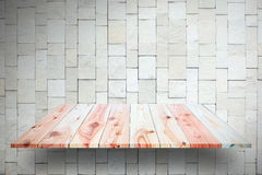 Wooden plank shelves and white Stone Wall background. For produc. T display Stock Image