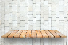 Wooden plank shelves and white Stone Wall background. Royalty Free Stock Photography