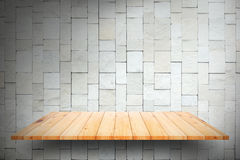 Wooden plank shelves and white Stone Wall background. For product display Royalty Free Stock Image