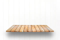 Wooden plank shelves and white wooden Wall background. Stock Photo
