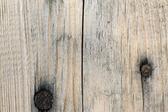 A wooden plank with two dark knickers. As a backgraond royalty free stock image