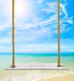 Wooden plank under picture of beach Royalty Free Stock Photos