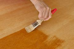 Wooden plank varnishing Royalty Free Stock Image