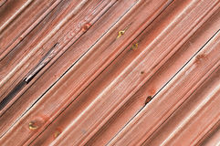 Wooden plank wall painted red Stock Images