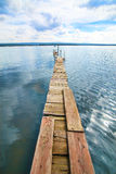 Wooden planked footway over the lake Royalty Free Stock Photography