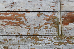 Wooden Planking Detail Texture. Detail of an exfoliating wooden planking originally coated with white colour royalty free stock photo