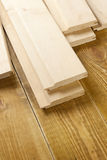 Wooden planks. Wood planks are on a wooden board Royalty Free Stock Images
