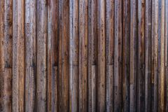 Old weathered planks outside facade. Wooden planks as an exterior wall finish are subject to the influences of the weather conditions stock images