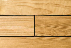 Bright hardwood oak planks background or texture. Extreme close-up of wooden planks stock photography