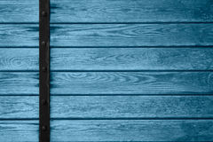 Wooden planks background with black metal bar. On left side or blue wood grain texture Royalty Free Stock Photography