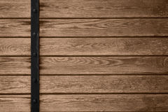 Wooden planks background with black metal bar. On left side or brown wood grain texture Stock Photos
