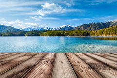 Wooden planks background with lake, Germany Royalty Free Stock Image