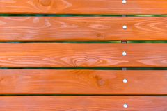 Wooden planks of bench standing in park macro. Wooden painted background stock images