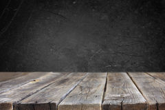 Wooden planks and black board background Royalty Free Stock Photos