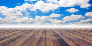 Wooden planks on blue sky background. 3d illustration. Wooden planks on blue cloudy sky background and copy space. 3d illustration royalty free illustration