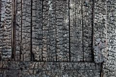 Wooden planks charred after the fire Royalty Free Stock Photo