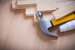 Wooden planks claw hammer construction plans on Stock Photo