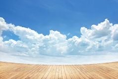Wooden planks with cloud and blue sky background royalty free stock image