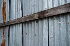Wooden planks on the corrugated galvanized sheet stock images