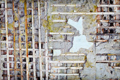 Wooden planks in damaged old concrete wall Royalty Free Stock Photo